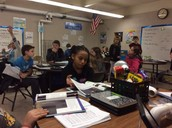 Students learning about the solar system in the 5th grade science lab.