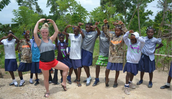 Material ( dancing ) Picture of me showing 14 year old Haitians how to hold a ballet pose.