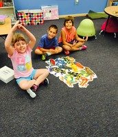 Maddie, John and Luella finished a hard puzzle together!