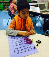 Uri developing number sense with tens frames