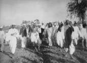 Gandhi traveling with his followers
