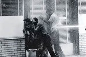 3 African Americans being sprayed by a Powerful Fire Hose