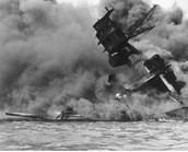 The USS Arizona burning during the attack