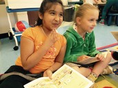 Daniela and Olivia are all smiles starting reading groups.