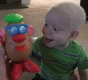 KJ imitating Mr. Potato Head