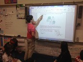 Student in fifth grade math lab showing his solution to a problem with multiple solutions