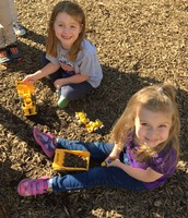 Girls have fun with dump trucks and bulldoziers too!