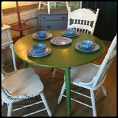 $315 - Green Drop Leaf Round Table with Two Leaves