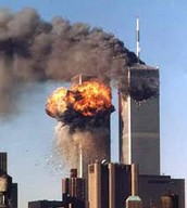 A picture of the twin towers during the terrorist attacks of 9/11