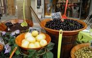 One vendor sells fresh olives, tapenade, and lemons.