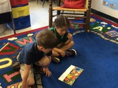 Natalie and Jax are discussing the life cycle of a butterfly.