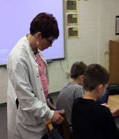 Ms. Graham (Science Teacher) drops in to check out student work.