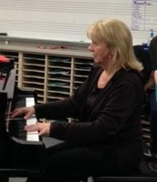 Mrs.Pease playing the piano to They Can't Take That Away From Me.
