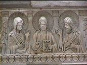 Battistero di Pisa, particolare della ghiera del portale est: Cristo affiancato dalla Vergine (a sinistra) e dal Battista (a destra), XII-XII secolo