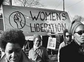 Feminist Movement- Women hold a sign in support for Women rights.