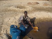 This man gets water for his crops in Somalia