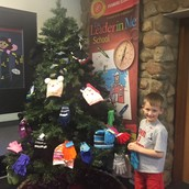 Giving to others through the mitten tree.