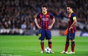 Messi and Xavi prepare a freekick