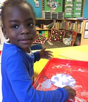 Sorea making a snowflake that she put in a salad spinner!