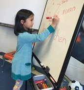 Stella showing us how to write and say her name in Chinese!