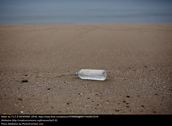 Bottled water polluting a beach.