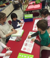 Working in our Handwriting books on grip and coloring - eyes on task! :)