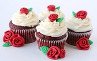 Chocolate flavor whit white topping and a red rosé