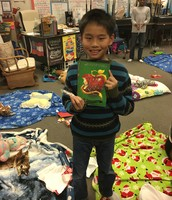 Thomas with his mega-gift! The new Descendants chapter book!