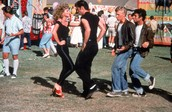 What elements from musicals like West Side or Grease do you see in any of the scenes from Rebel Without a Cause?