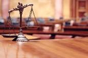 The Symbol for Defendant and Plaintiff