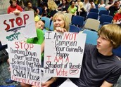 Parent/student protests against Cuomo's policies.