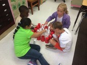 Learning to work together in Mrs. Gregory's class.