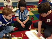 Daire and Owen reading as a group