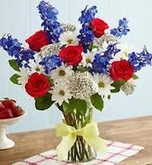 Red roses with white daisies, delphinium and Queen Anne's Lace