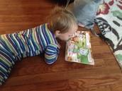 Ross loving his books!