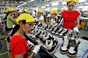 Workers at a Nike Sweatshop in Vietnam.