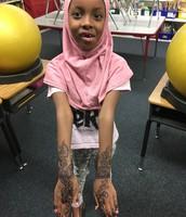 Showing her beautiful henna