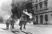A block of housing on fire as a result of the Jewish uprising in the Warsaw ghetto in April and May 1943.