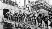 Soldiers boarding a ship to be sent off the war