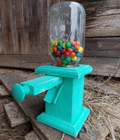 Pull type candy dispenser