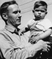 Paul Jobs holding his son Steve Jobs