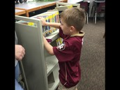 Gavin practicing how to get a book