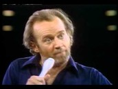 "Carlin performs his ""seven dirty words"" act"