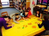 Fourth graders work on author welcome poster