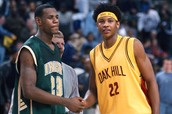 LeBron shakes hands with Oak Hill star Carmelo Anthony.