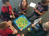 Mrs. Hunt's class is learning how to play reading games in a group