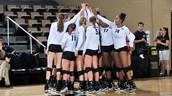UCF volleyball team celebrates after a win