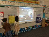 Riley B. & Mila keep track of the numbers during Mystery Skype