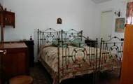 Camera da letto appartamento Buganville