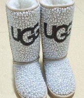 Pearly uggs with ugg on the front